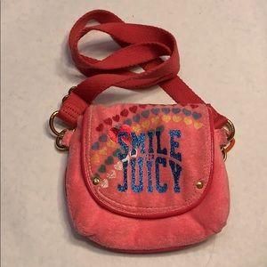Juicy Couture pink crossbody children's bag.